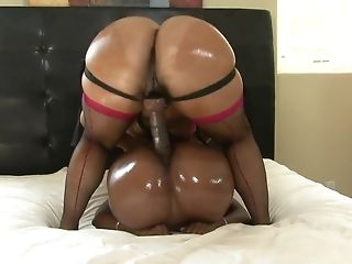 Dark-hued lesbos at hand elastic asses use belt cock playthings connected with couch sextube